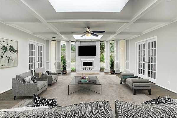 Photo #1 Large  bright updated living room with marble fireplace , crown molding, and 2 skylightsvirtually staged.