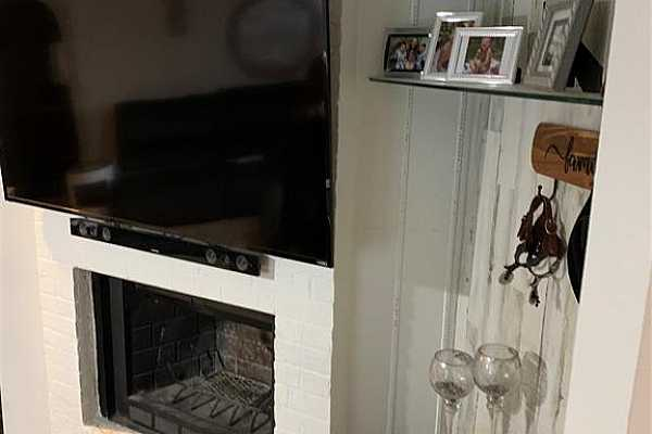 Photo #4 Niches for art with the coziness of a fireplace