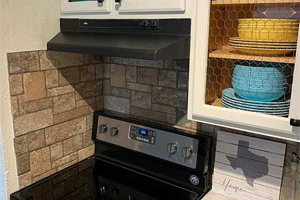 Photo #5 Both cabinet and counter space with updates