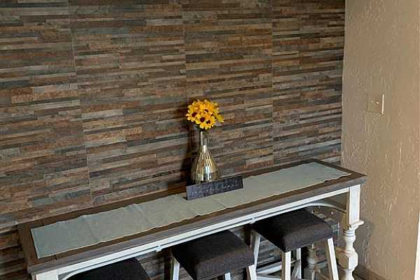 Photo #8 Dining area with tile backdrop