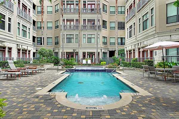 Photo #1 Welcome home to the Lofts on Post Oak featuring (6) pools!