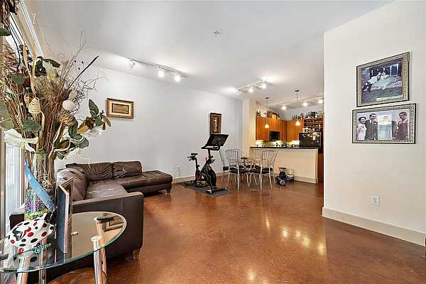 Photo #9 Complete with stained concrete flooring, this ground-level 2BR home offers plenty of space!