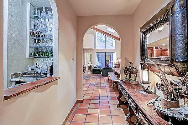 Photo #3 Gorgeous entrance with an arched hallway. How inviting!