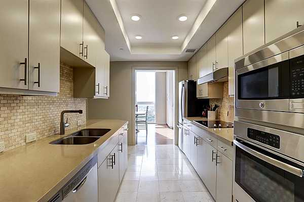 Photo #7 The sleek gourmet galley-style kitchen is a chef