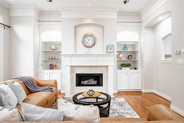 Photo #5 Lovely spacious living room with built-ins, high ceilings, recessed lights, gas log fireplace and handsome Oak hardwood floors bring distinctive and warm look to this cozy room.