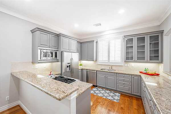Photo #8 Updated kitchen (2021) with sophisticated and elegant simplicity creating an appealing contrast and welcoming feel. A window over the sink is a beloved trend and provides more light.