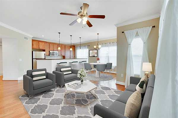 Photo #11 The perfect space to unwind after a long day, enjoying friends and family or socializing on the weekends. This location and the layout is where you want to be! Live life! (Virtually staged)
