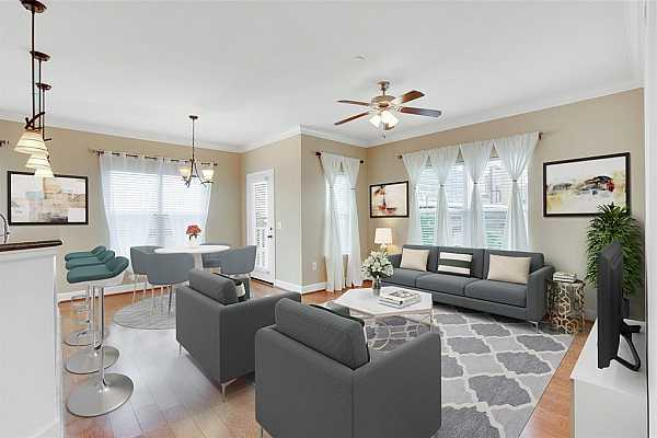 Photo #9 Gorgeous!  Entertain your guests and enjoy life in this open and very spacious living area. This space is enhanced by the beautiful natural light flowing in the windows overlooking city views. Warm & inviting! (Virtually staged)