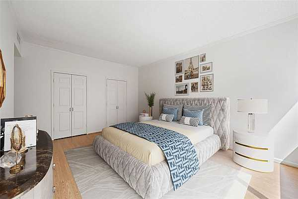 Photo #7 Imagine waking up to the morning sunlight generously flowing into this capacious primary suite! Relax and retire to this peaceful enclosure, with its own sizeable closet & an ensuite bathroom with a tub and shower. This virtually staged bedroom flaunts a space made for modern living with its wide windows and large wall space.