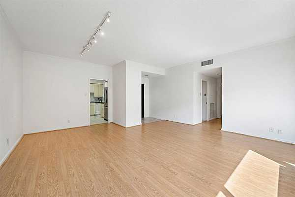 Photo #10 The high ceilings, crown molding, and sleek laminated flooring elevate the unit