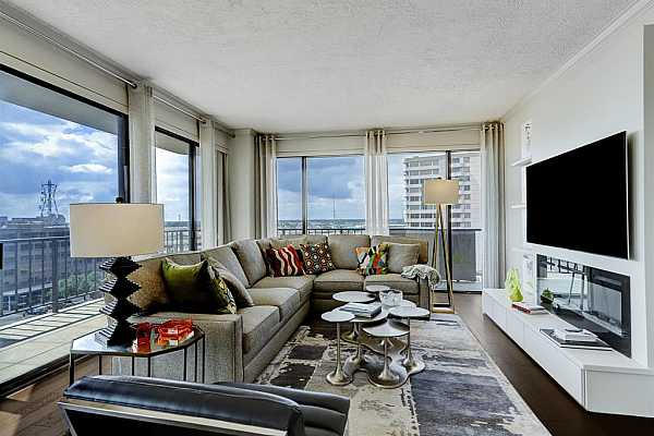Photo #3 Located on the 9th floor and beautifully and professionally remodeled by present owners.  Floor to ceiling windows offer both east and south city views. The wrap around balcony can be accessed  from the living area, the breakfast room, and also from the primary bedroom.