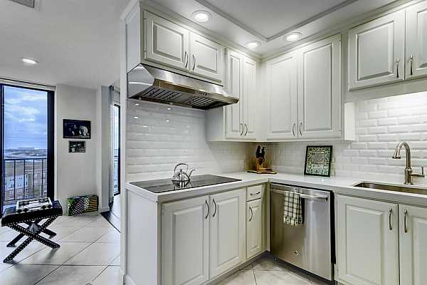 Photo #10 White subway tile is featured in the pretty remodeled kitchen