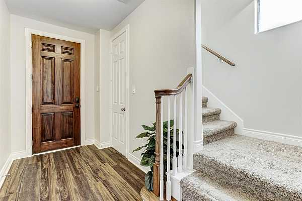 Photo #7 Beautiful entry that leads to the stairwell and first floor room!