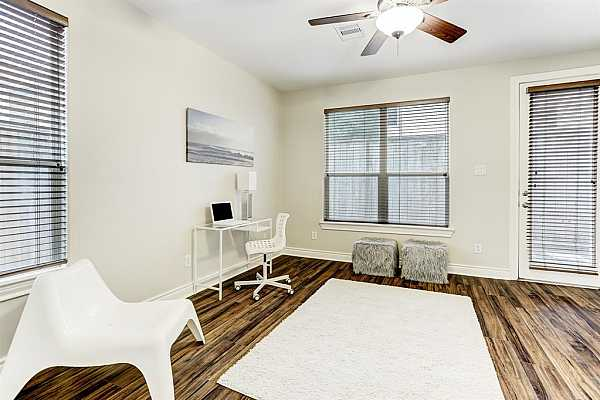 Photo #8 This room on the first floor can be used as an office, gameroom, or guest bedroom!