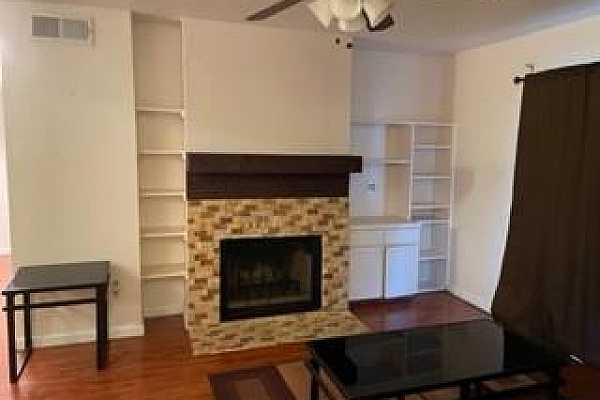 Photo #1 Great fireplace and tons of storage. Living room & both bedrooms have ceiling fans. All furniture can remain if wanted.