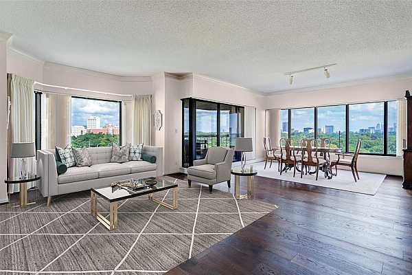 Photo #1 Amazing possibilities here!  There is so much space to work with in this living/dining combo and with fabulous views of Downtown, Hermann Park and the Medical Center, what