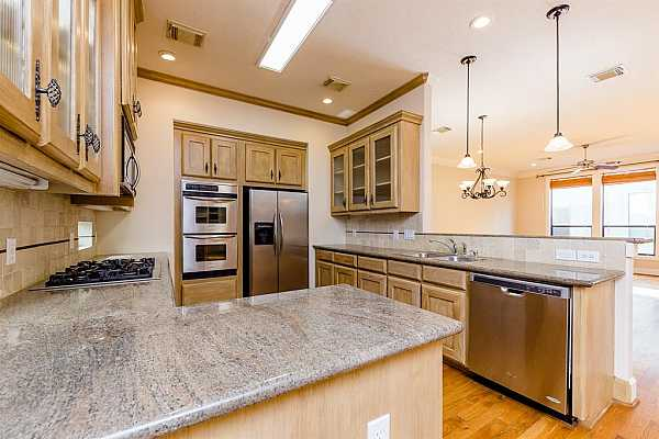 Photo #12 Huge kitchen with plenty of counter space, cabinets, and build-in appliances