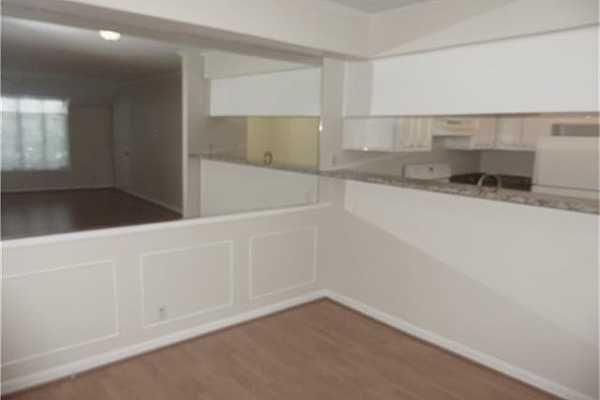 Photo #5 Dining room and breakfast bar.