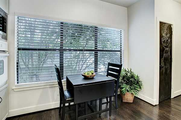 Photo #12 Breakfast nook off the kitchen. There is a hall that features a pantry and the utility room.