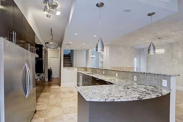 """Photo #8 Convenient """"eat-in"""" space graces the kitchen that features dual cabinetry pantries with adjustable shelving."""