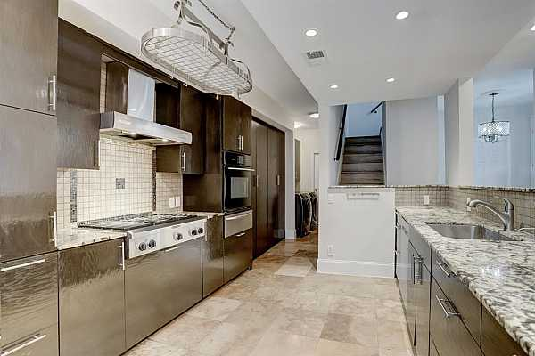 Photo #9 Note the ample cabinetry and custom, stainless steel pots and pans receptacle displayed from ceiling.
