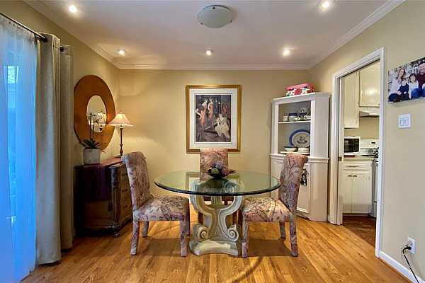 Photo #4 The breakfast/dining room features an open concept and seamlessly flows into the living area