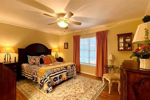 Photo #8 This spacious bedroom has ample room to fit your large bed and furniture and features a large walk-in closet as well