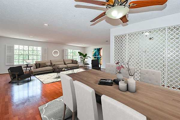 Photo #10 Living and dining areas virtually staged