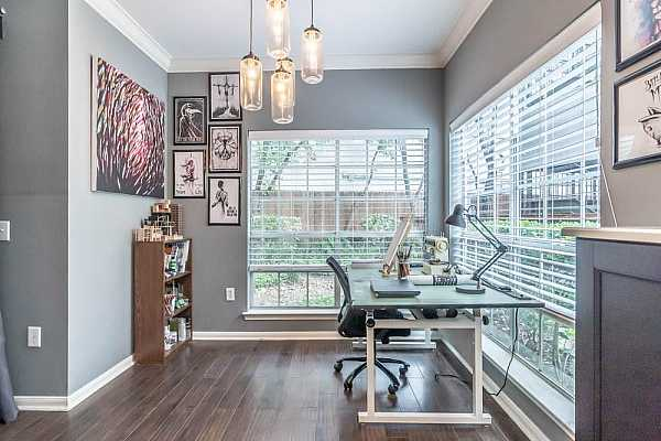 Photo #7 The homeowners converted their dining space to a creative workspace.