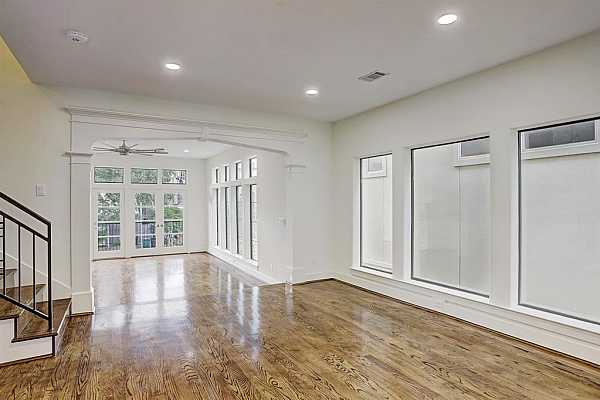 Photo #11 View of Dining Room showcases the adjacency to the living room.  Note the large picture windows!