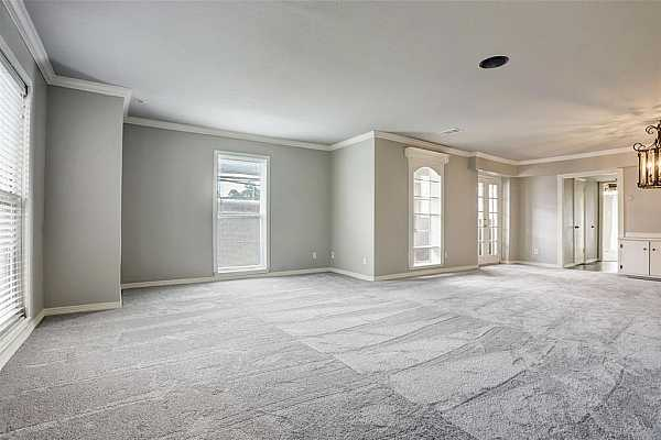 Photo #5 Greeted in well cared for home with fresh paint and new carpet. Lots of natural light floods this corner unit townhouse. Notice the custom millwork throughout.