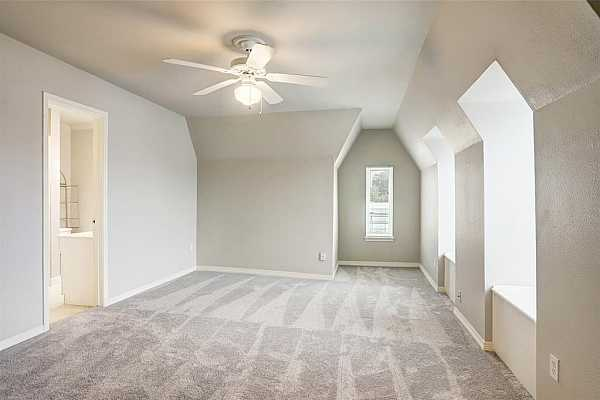 Photo #9 This is one of the two large bedrooms upstairs. The dormers provide a lot of natural light throughout.