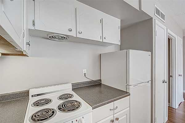 Photo #3 This kitchen has been recently updated and has a stainless steel dishwasher. Fridge comes included!