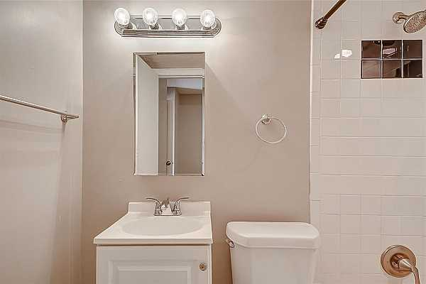 Photo #6 This bathroom comes complete with tons of updates! It has a shower & tub as well as an updated vanity.