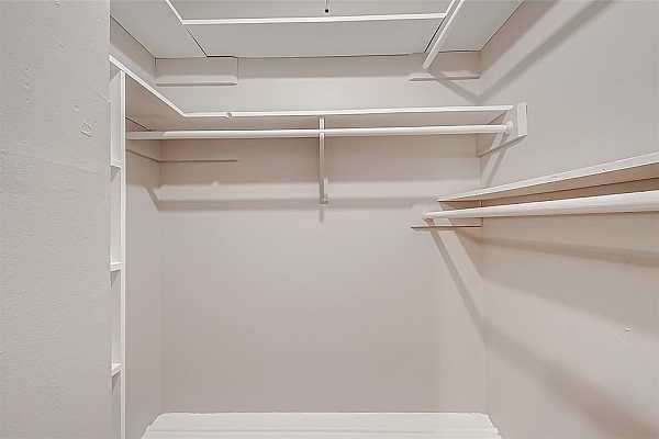 Photo #10 The bedroom has a spacious closet with plenty of storage space for your shoes and clothes!