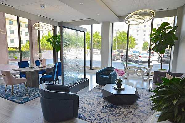 Photo #4 Elegant entry lobby with plenty of seating for your guests when they arrive