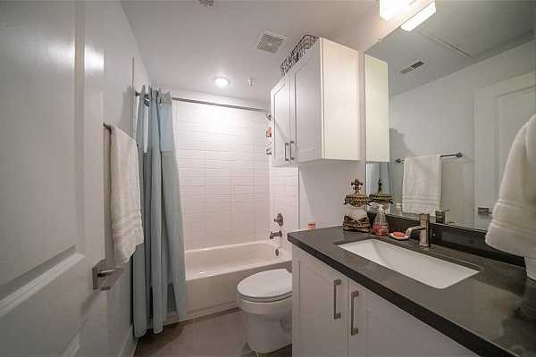 Photo #12 Bathroom with white subway tile and silestone counter tops. Cabinets to store your linens and towels.