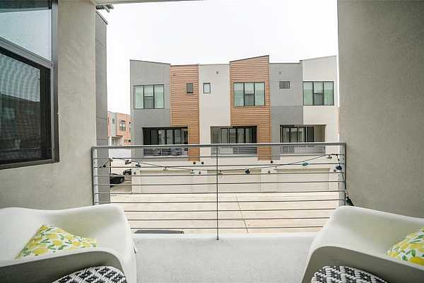 Photo #9 Balcony off kitchen/living room. Can sit outside and have your morning coffee or come home from work and enjoy a glass of wine.