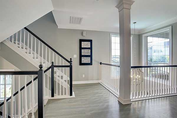 Photo #7 Hardwood floors were installed on the stairways and third floor bedrooms. The entire home has solid floor surfaces - either tile or hardwoods.  Once again notice the oversized windows even in the stairways.